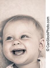 Smiling baby lying on back