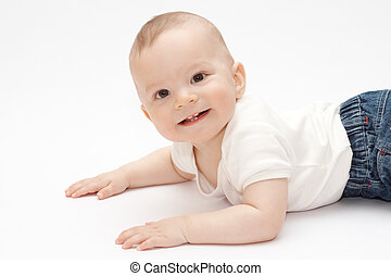 smiling baby lying on the floor