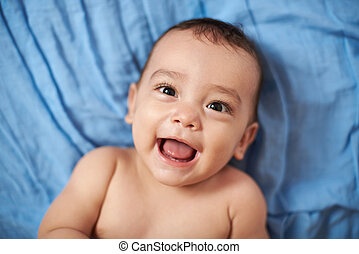 smiling baby on blanket