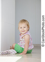 smiling baby on floor