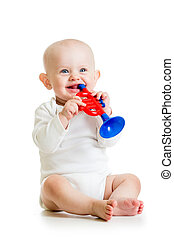 smiling baby playing with musical toys isolated on white background