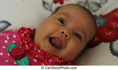 Smiling Baby - Close up with a 2 month little baby girl...