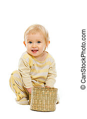 Smiling baby with basket on white background