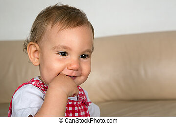 Smiling Baby with finger in mouth
