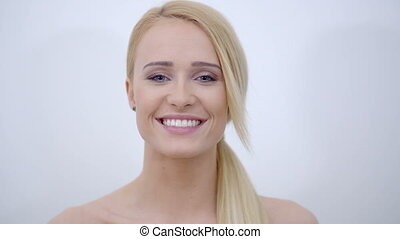 Smiling Bare Woman Touching her Face