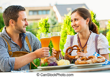 Smiling bavarian couple at Oktoberfest