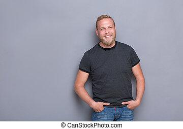 Smiling bearded man - Portrait of happy bearded man on grey...