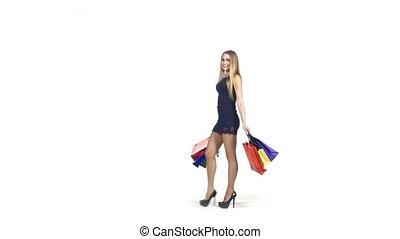 Smiling, beautiful, blonde girl in short dark blue dress...