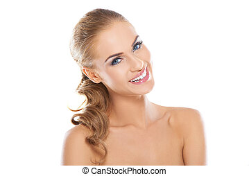 Smiling beautiful blonde woman with long curly hair posing ...