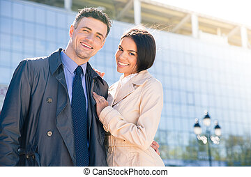 Smiling beautiful couple hugging outdoors