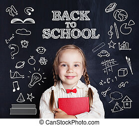 Smiling beautiful cute little girl leaning with books. Back to school.