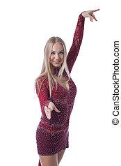 Smiling beautiful dancer posing in sexy dress