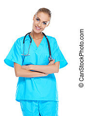 Smiling beautiful doctor in scrubs