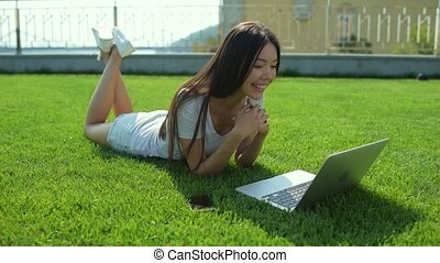 Smiling beautiful girl having video conversation
