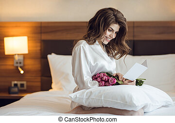 Smiling beautiful girl with flower
