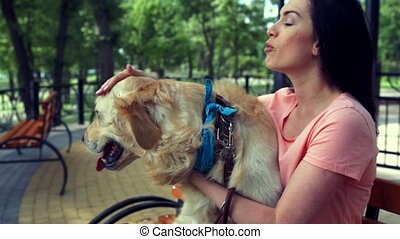 Smiling beautiful woman enjoying time with her dog