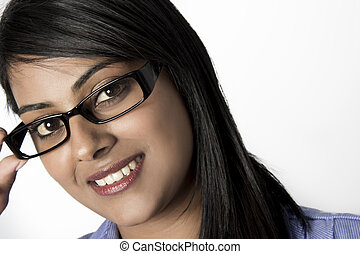 Smiling Beautiful Woman hold her framed glasses