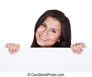 Smiling beautiful woman holding blank banner
