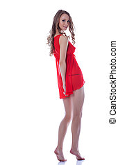 Smiling beautiful woman posing in red negligee