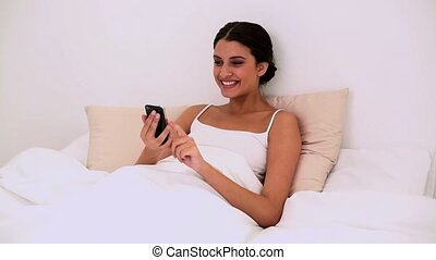 Smiling beautiful woman using a mobile phone