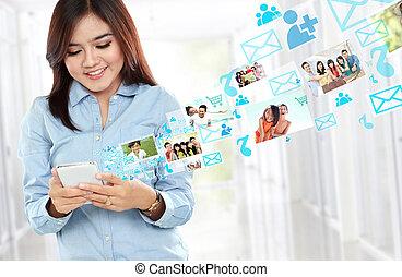 Smiling beautiful woman using mobile phone