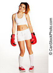 Smiling beautiful woman wearing boxing gloves