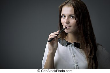 Smiling beautiful woman with ecigarette - Smiling beautiful...
