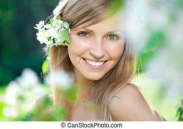 Smiling beautiful woman with flowers