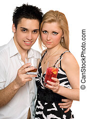 Smiling beautiful young couple with cocktails