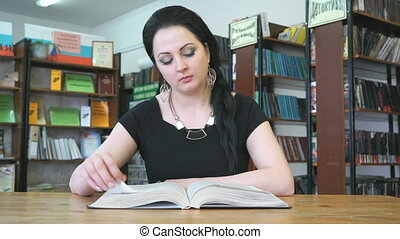 Smiling beautiful young woman at library