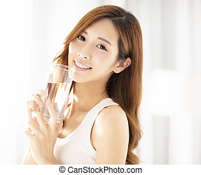 smiling beautiful young woman drinking water