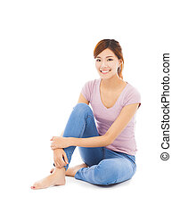 smiling beautiful young woman sitting on the floor