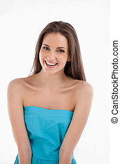 Smiling beauty.  Attractive young woman in blue dress looking at camera and smiling while standing isolated on white