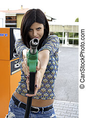 Smiling beauty pointing special gasoline gun fun