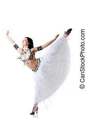 Smiling belly dancer gracefully posing in studio