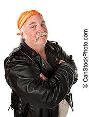 Smiling biker gang member with leather jacket