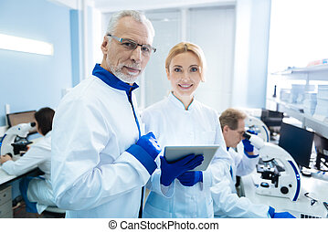 Smiling biologists discussing gene research - Working on...
