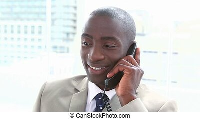 Smiling black businessman on the phone