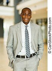 black businessman posing in office