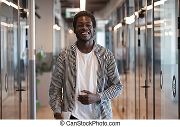 Smiling black businessman professional looking at camera standing in office