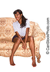 Smiling black girl on coach retro style portrait