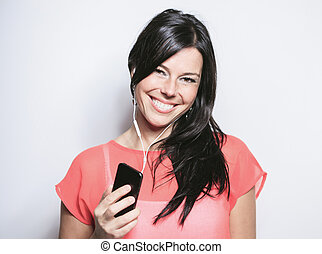 Smiling black hair woman on grey background