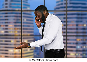 Smiling black man with phone.