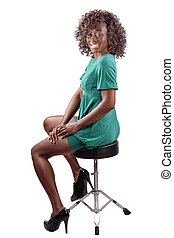 Smiling Black Woman Sitting on Stool Dress