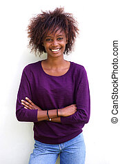Smiling black woman standing against white background