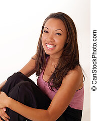 Smiling black woman with braces on upper teeth