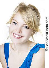 Smiling blond girl in blue
