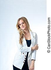Smiling Blond Girl In White Jacket