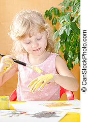 blond girl painting with brush