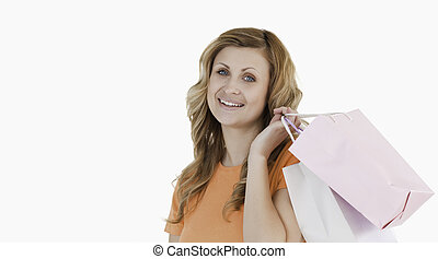 Smiling blond-haired woman showing her shopping